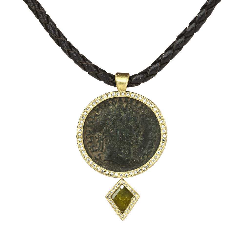 ancient coin yellow pendant on leather