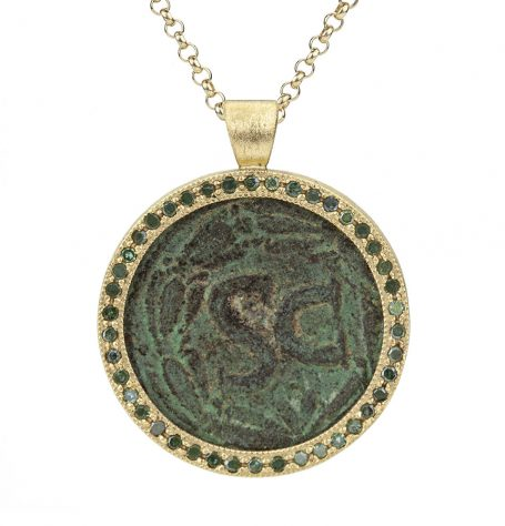 Antique coin with green diamonds