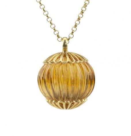 Carved citrine & gold pendant